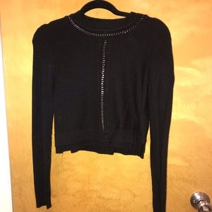 Cropped sweater with chains detail
